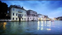 Tracking shot of happenings on the Grand Canal at dusk