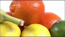 Close shot of varied fruits on a white screen.