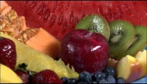 Close shot of varied fruits on a spinning plate.