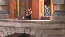 Woman jogging and stretching in a Italian architecture arcade.