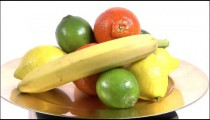 Assortment of fruit on a spinning plate on a white screen.