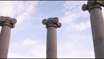 Low-angle slow pan of ionic columns