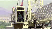 A construction worker operates a crane high above Salt Lake City