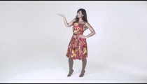 Young woman plays with skirt while dancing