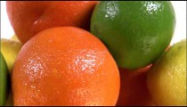 Close shot of varied fruit rotating on a white screen.