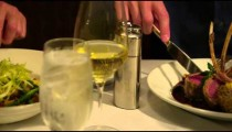 Left to right panning of hands at a table place setting