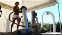 Woman running on a treadmill at a resort.