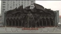 "Shot of a statue of soldiers labeled ""For Peace"" in China."