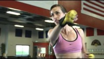 Close up of a focused woman shadow boxing