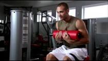 Man doing sitting curls in a gym.