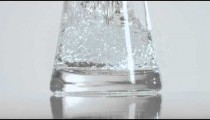 Close up of a glass container being filled with water.