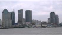 Skyscrapers with huge company logos alongside Huangpu