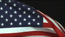 Close up of the American flag rolling in the wind.