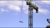 Building materials are hoisted in the air by a crane