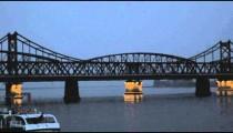 Panning shot of two suspension bridges in China.