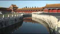 Still shot of a Chinese courtyard with a canal.