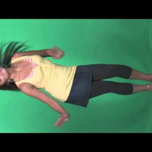 Young dark haired girl dances against a green screen