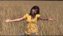 Woman in wheat field meditating
