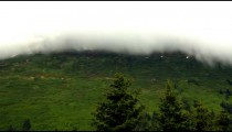Time-lapse of cloud movement over a green hillside near Seward, Alaska.
