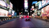 Time lapse in Times Square with people walking around the plaza.