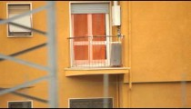 Close-up tracking shot of an orange house in Italy