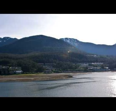 Traveling time lapse of the cruise ships and miscellaneous boats in the port in Juneau, Alaska.