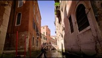 View from a gondola as it glides through a back alley canal