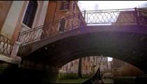 Slow motion shot of gondola under bridge