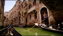 Gondolas pass under a bridge in slow motion