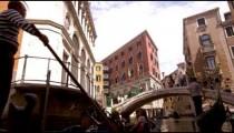 Slow motion shot of two gondolas by bridge