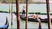 Gondolier directs boat out to the Granda Canal in slow motion