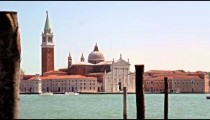 Slow motion shot of the Church of San Giorgio Maggiore from across the canal