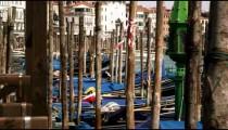 Slow motion shot of docked gondolas bobbing