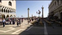 Slow motion shot of people entering and exiting Piazza San Marco
