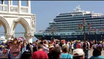 Slow motion shot of cruise ship pulling up near Piazza San Marco