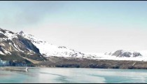 Time lapse shot in Alaska. Shows snow covered mountain ranges and a clear blue sky in background.