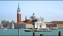 Slow motion shot of boat passing in front of San Giorgio Maggiore