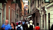 Slow motion shot of people moving down narrow street