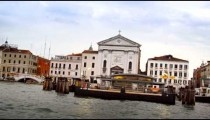 Buildings, including Roman Catholic church, from canal in Venice.