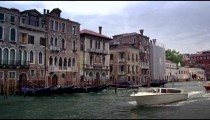 Motor boats, gondolas, and buildings of the Grand Canal.