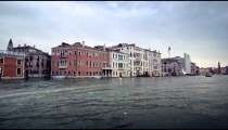Tracking footage of buildings on the waterline of the Grand Canal.