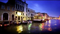 Tracking shot of the Grand Canal and its buildings at night