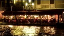 Restaurant seating area ont he waterside at night