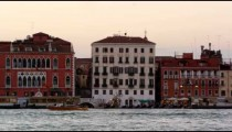 Panning shot of the wharf along the San Marco canal and boats.