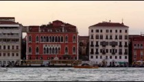 Panning shot of Piazza San Marco and the wharf.