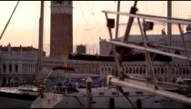 Static shot of Piazza San Marco and the Doge's palace seen through sailboats.
