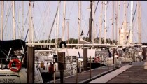 Static shot of sailboats docked in the marina at dusk.