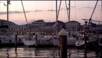 Panning shot of sailboats at the marina of San Giorgio Maggiore, Venice.