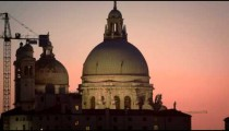 Static shot of Santa Maria della Salute and bird flying by.