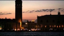 Slow panning down shot of Piazza San Marco and the Doge's palace ending still on the canal.